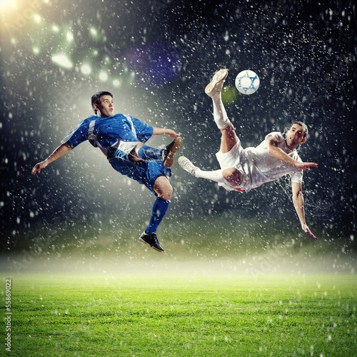 canvas print picture two football players striking the ball