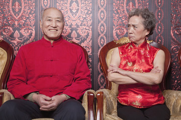 Angry Grandmother and Happy Grandfather in Traditional Chinese Clothing
