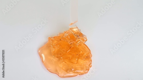 Orange fluid gel on whitebackground