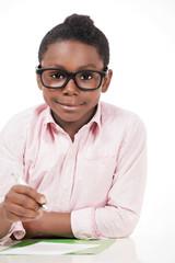 Child education, cute smiling boy writing