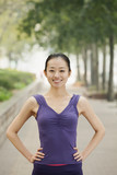Confident Young Woman in Exercise Clothes in the Park