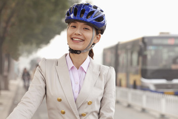 Young Business Woman commuting with a Bicycle, Beijing, China