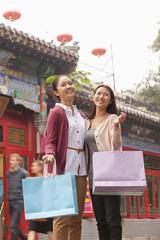 Two Young Women Shopping Outdoors