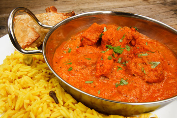 Chicken tikka masala in balti dish with rice