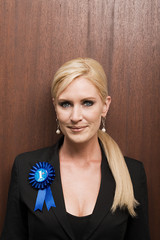 Businesswoman wearing rosette
