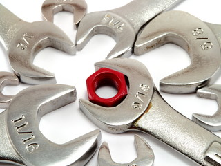 Red nut and metal wrenches