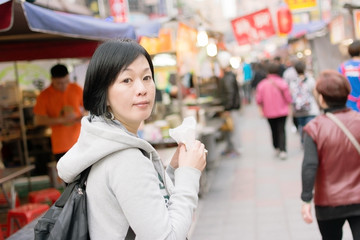 Mature Asian women at street