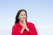 Concerned thoughtful woman praying hands