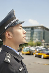 Police Officer looking up, profile