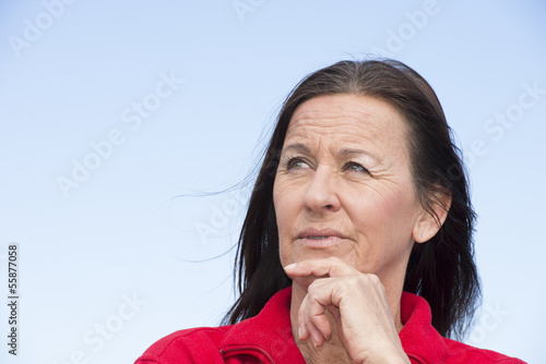 Daydreaming thoughtful mature woman