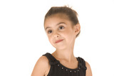 young girl in black leotard with sparkly eyes head tilted