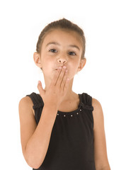 young girl in black leotard with sparkly eyes blowing kiss