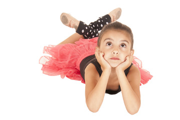 young girl happy in pink tutu black leotard laying down