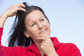 Stressed worried woman scratching head