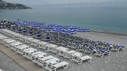 Lounge chairs and parasol on the beach, southern France