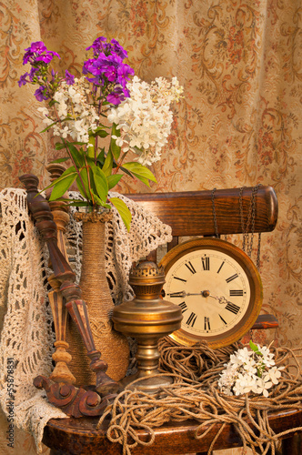 phlox bouquet on the old chair with antique clock