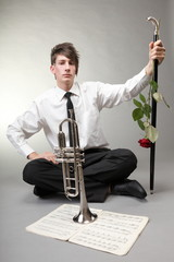 Boy with a trumpet loves music