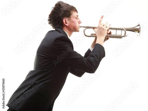 Portrait of a young man playing his Trumpet