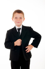 little boy in a black suit on a white background