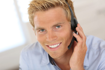 Smiling attractive customer service representative