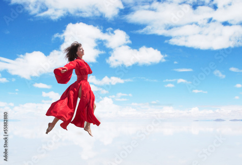 Woman in red kimono running on air