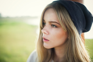 beautiful girl in a cap hipster