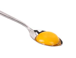Egg yolk on a silver spoon