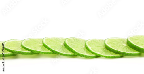 Slices of green lemon