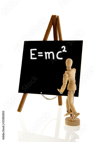 Wooden teacher in front of blackboard