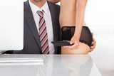 Intimate couple in office