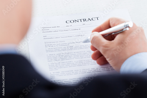 Businessman Filling The Contract Form