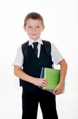Little boy with a school backpack and books