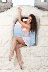 Brunette on the stone wall