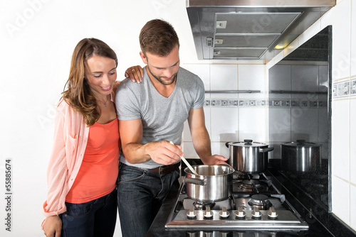 Couple Cooking A Meal On Stove