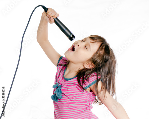 Asian girl singing with microphone