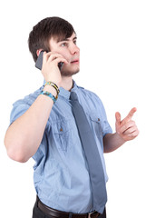 Young businessman calling by phone