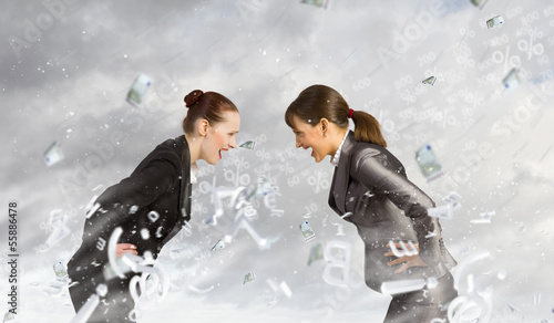 Two businesswomen arguing