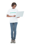 Cheerful volunteer woman using laptop