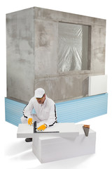 Worker measuring an insulation panel