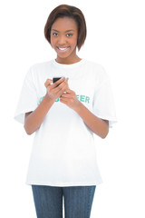 Smiling woman using her mobile phone