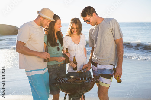 Cheerful young friends having barbecue together