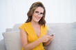 Cheerful pretty woman with glasses using phone