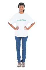 Serious black haired volunteer posing with hands on the hips