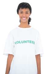 Content black haired volunteer posing looking at camera