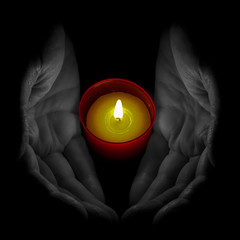Hands with votive candle - selective colour / monochrome