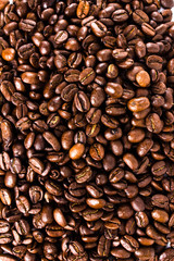 Roasted Coffee Bean background or texture concept. Closeup of co