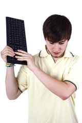 Young man smashes keyboard