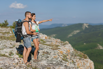 Hikers with backpacks enjoying valley