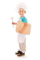 Happy little chef with wooden board and spoon