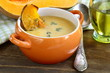 pumpkin cream soup with pieces roasted pumpkin and thyme